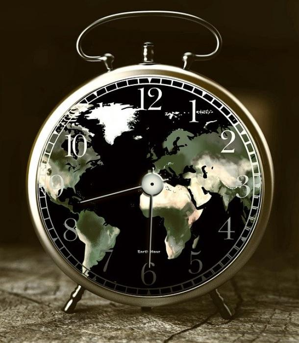 Image of the earth shown s a clock face