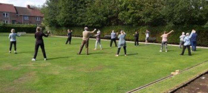 Photo of Tai Chi clases taking place