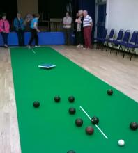 Photo of indoor bowling in action.