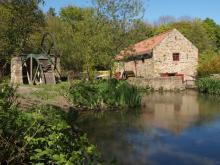 A photo of the the Pond and water mill
