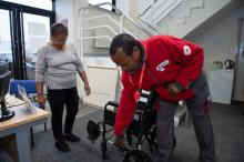 Volunteer with a wheelchair
